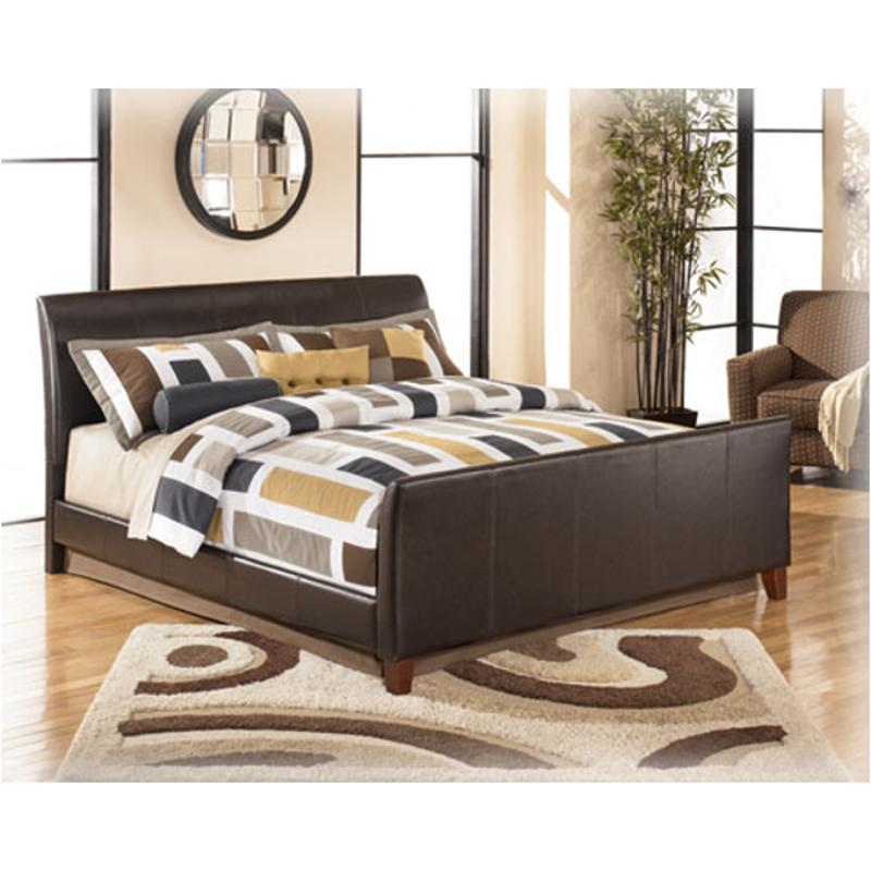 brown queen design furniture signature headboard by desig stanwick ashley bed upholstered